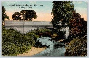 Ida Grove Iowa~Cement Arch Wagon Bridge near City Park~Stumps in Creek~c1910 PC