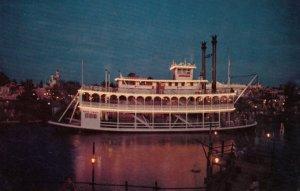 DISNEYLAND, 1950s-60s; Night time trip on the Mark Twain paddle-wheel Steamboat