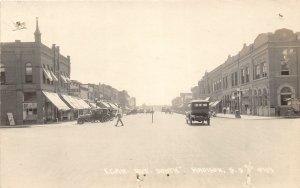 G12/ Madison South Dakota Postcard RPPC c1920s Egan. Ave. Stores Autos 4