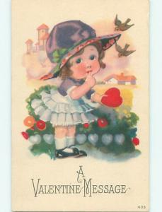Unused Divided-Back valentine CUTE GIRL IN PURPLE HAT HOLDING HEART r4035