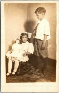 Vintage RPPC Real Photo Postcard Boy & Girl with Doll - Studio Photo c1910s