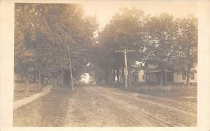 Colton New York~Homes Along Wide Dirt Road~Telephone Poles~c1914 RPPC