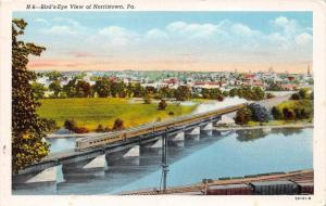 Aerial View of Norristown Pennsylvania  with  train on bridge over river