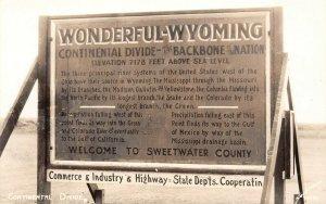 LP70  Continental Divide  Wyoming  RPPC Postcard Roadside Sign