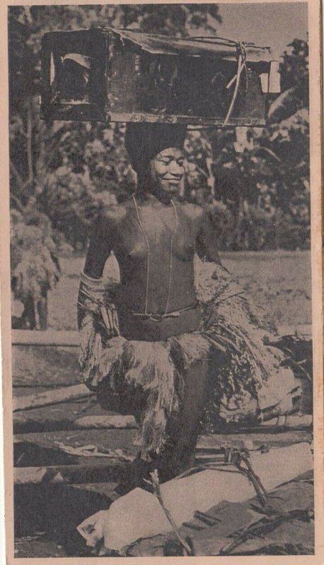 PAPA NEW GUINEA, 1910-30s; Topless Woman carrying box on head