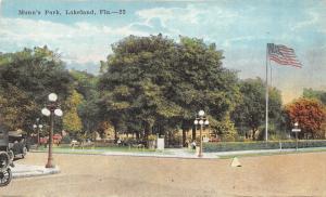 Lakeland Florida~Munn's Park~People Sitting under Trees~Sidewalk Sign~Flag~c1910