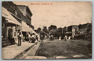 Frankford Missouri~Man Carries White Package on Main Street~Stores~Ladies~1908