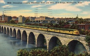 Steamliner,Train Crossing Mississippi River,Stone Arch Bridge,Minneapolis,MN
