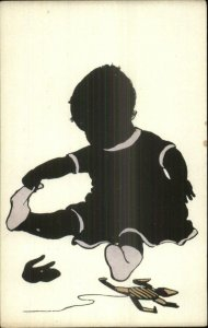 Silhouette - Baby Pulling Socks Off - Toys c1910 Postcard