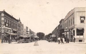 Sheldon Iowa~Ninth Street East~Gibson's Meat Grocer~Hardware~Bakery~1929 RPPC