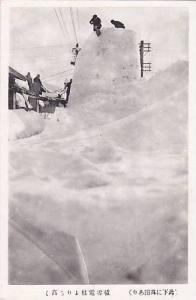 Snow covered town , Japan , 20-40s , People on tall mound of snow