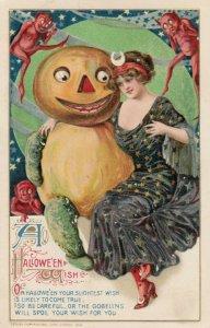 HALLOWEEN , 1912 ; Woman hugging a Jack O'Lantern Man ; WINSCH