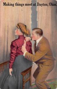 Dayton Ohio Greetings Man Buttoning Womans Dress Antique Postcard J70069