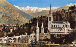 France Lourdes La Basilique et la montagne enneigee Basilica