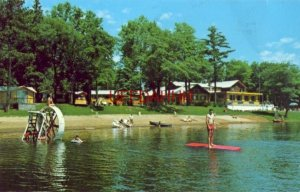 guests enjoy the beach at RUTTGER'S BAY LAKE LODGE, DEERWOOD, MN 1968