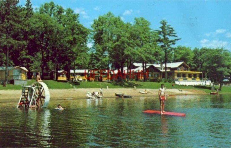 guests enjoy the beach at RUTTGER'S BAY LAKE LODGE, DEERWOOD, MN 1968
