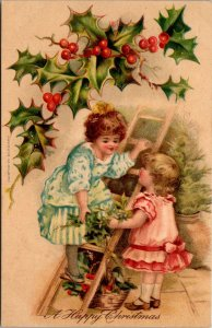A Merry Christmas - KIDS CHILDREN Ladder Holly Missletoe - POSTCARD PC POSTED