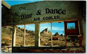 Oatman, Arizona Postcard Ghost Town Burned Out Bar Scene Dine & Dance Sign