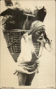 Ethnography Nepal Native Man Carrying Load of Wood c1910 Real Photo Postcard