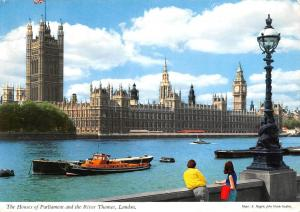 England London The Houses of Parliament and the River Thames ships