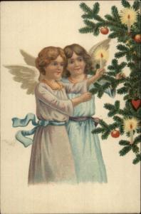Christmas - Little Girl Angels Lighting Tree c1910 Postcard