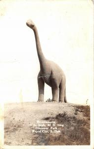 Rapid City South Dakota 1948 RPPC Real Photo Postcard Brontosaurus Dinosaur
