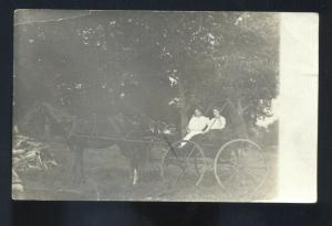 RPPC LAWRENCE KANSAS HORSE DRAWN WAGON PRETTY GIRL REAL PHOTO POSTCARD