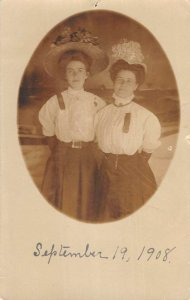 1908 two young ladies in perioid appropriate dress real photo pc BB3098