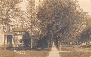 Sanborn Iowa~Residential Street~Homes on Tree Lined Dirt Road~Porch~1915 RPPC