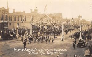 St Peter MN~German Catholic Benevolent Assn Convention Parade~Garage~1911 RPPC