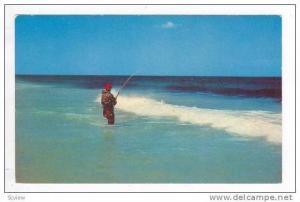 Bass Fisherman in surf, Cape Cod, Massachusetts, USA 1950-60s
