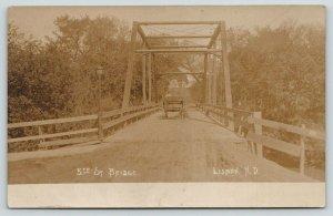 Lisbon North Dakota~Boys in Horse Wagon on 5th Street Bridge~c1912 RPPC
