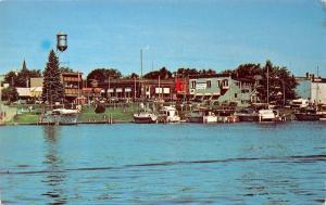 Charlevois Michigan~Shops Behind Round Lake Harbor~1977 Postcard