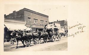 Laramie WY Street View Stage Coach 7-4-1916 RPPC