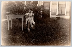 Real Photo Postcard~Little Old Girl on Candlestick Telephone Outside~1920s RPPC