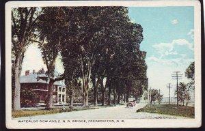 P1546 old unused postcard waterloo row & c.n.r. bridge fredericton n.b canada