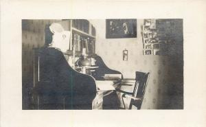 Old Roll-Top Desk~Real Photo Postcard~PCs on Wall~Books, Bible? on Shelf c1913