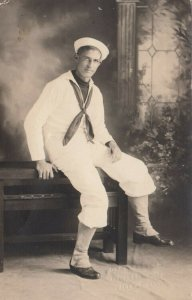 RP: Young Sailor sitting on table, 1900-10s