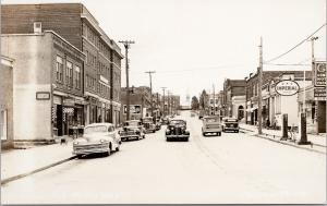 Haileybury Ontario Street Scene Mike's Barber Imperial Gas RPPC Postcard E62