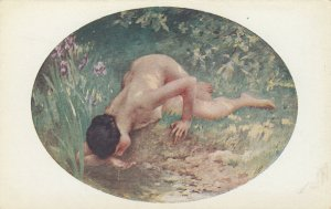 Nude woman drinking from creek, 1900-10s