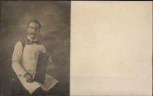 Man in Studio Apron & Book Honesdale? PA Uncle John Rodemeyer on Back RPPC
