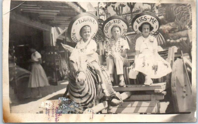 1950s Tijuana BC Mexico RPPC Photo Postcard Children on Donkey Cart w/ Sombreros