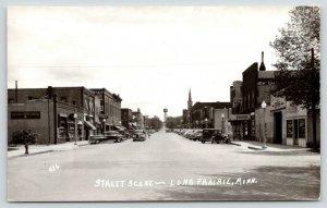 Long Prairie MN~Main Street~Hotel~HC & Sons Garage~Home Bakery~Cars~1940 RPPC