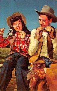 Western RIDE EM & ROLL EM Cowboy & Cowgirl Rolling Cigarettes SMOKING Postcard