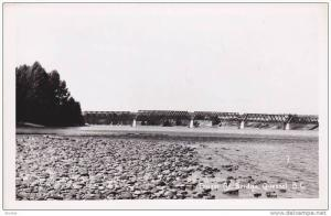 RP, Shoreline View of Fraser River Bridge At A Distance, Quesnel, British Col...