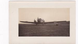 RP; Mono-plane sitting next to Junker Tri-motor airplane , 1920-30s
