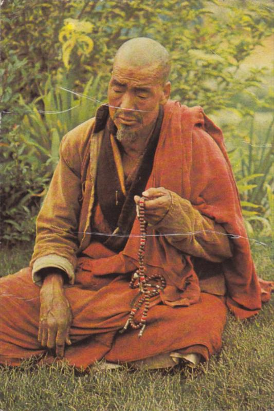 BHUTAN , PU-1978 , A lama in deep prayer