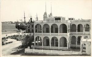Vintage Real Photo PC; Massaua, Eritrea, Red Sea Colonial Bldg, Ship at Port
