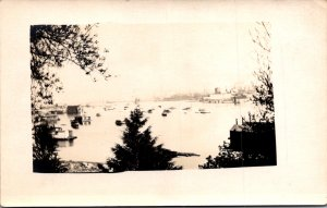 RPPC view of a harbor beach houseboats boats fishing boats industrial