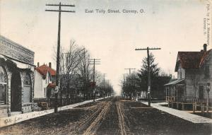Convoy OH~Handcolored~Sharp Stone Arch Bldg~Family Homes~Tracks on Dirt St 1909